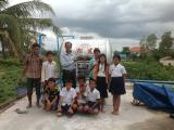 Founder & students joined a photo at water tank-storage at ACO